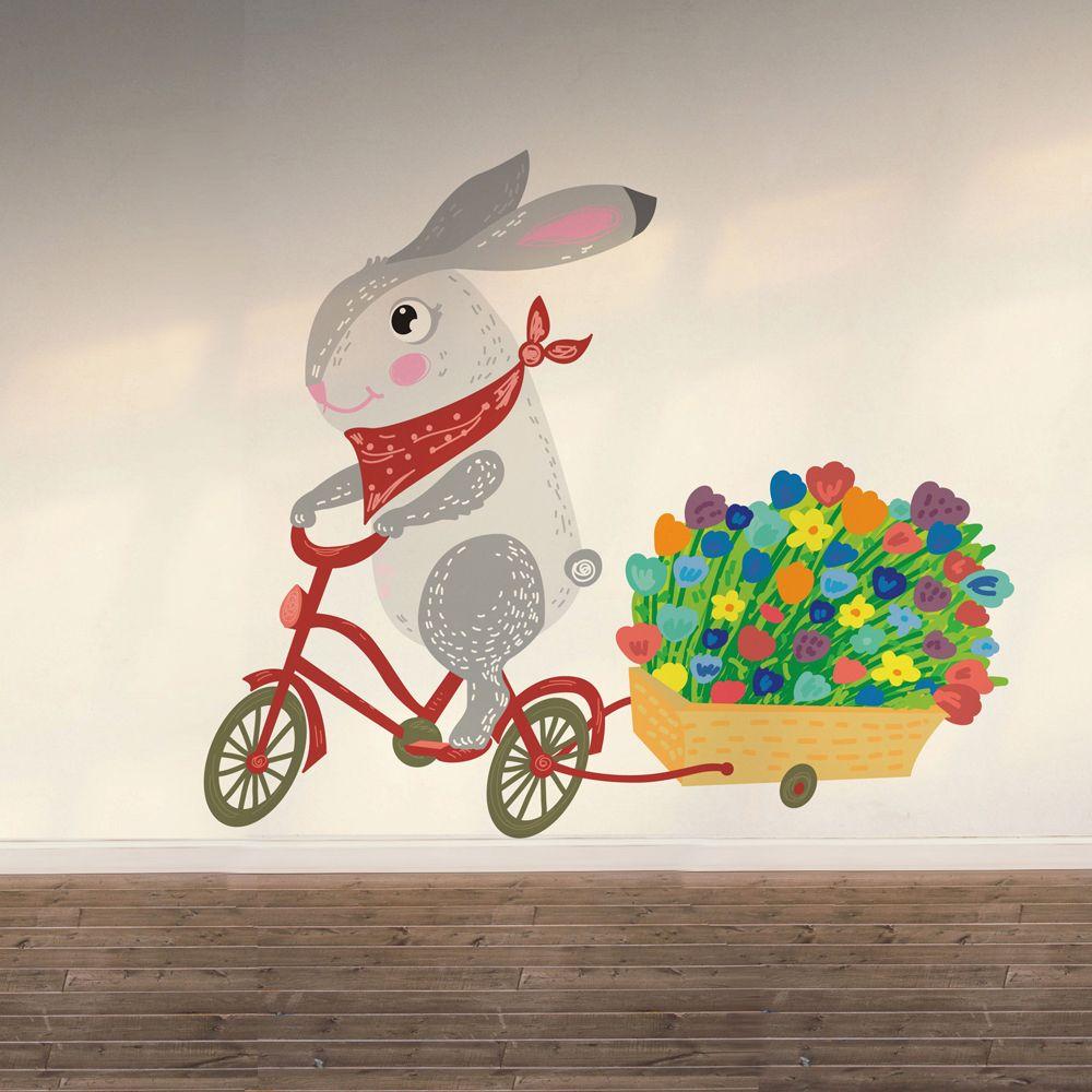 Изображение Заяц на велосипеде и с цветами